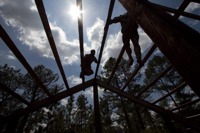 Paratroopers with the 82nd Airborne Division's 3rd Brigade Combat Team climb an obstacle during a team obstacle course competition May 16, 2011, at Fort Bragg, N.C.  The competition is part of All American Week, five days of celebration and