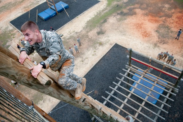 Paratroopers with the 82nd Airborne Division participate in a  team obstacle competition during the second day of All American Week, May 16-20, 2011, at Fort Bragg, N.C.  The week includes sporting activities, picnics, a division run, memorial and