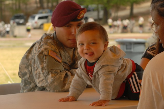 Spc. Donovan Saucedo, Headquarters and Headquarters Battery, 18th Fires Brigade (Airborne), watches his 8-month-old son, Gabriel, at a regimental picnic May 17 on Fort Bragg, NC. The picnic was held as part of the 82nd Airborne Division All American