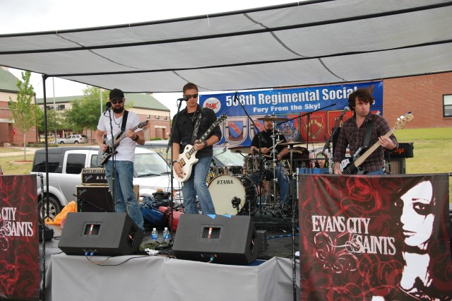 Evans City Saints performs for 4th Brigade Combat Team Paratroopers and their Families at the 508th Parachute Infantry Regimental Picnic Tuesday. The band came as part of a performance organized by The Rock Shop of Fayetteville, a local business who