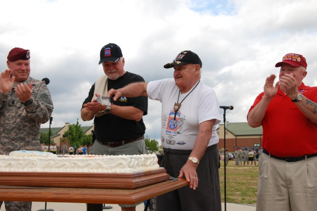 508th Parachute Infantry Regiment alumni assist with the cutting of the cake at the regimental picnic Tuesday as Command Sgt. Maj Mark Sturdevant, 4th Brigade Combat Team Command Sgt. Maj., looks on.""