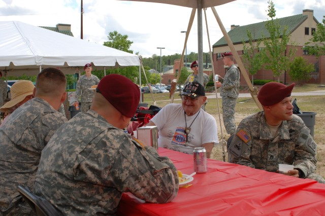 4th Brigade Combat Team, 82nd Airbrone Division Paratroopers spend time with veterans at the 508th Parachute Infantry Regimental Picnic Tuesday. The picnic was held to celebrate the Paratroopers of today as well as to allow current Soldiers to see their