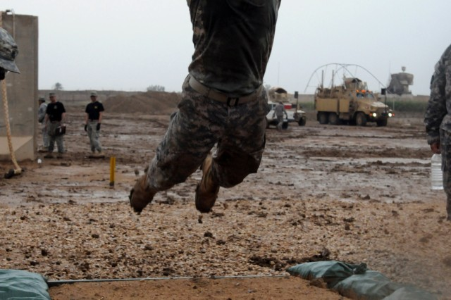 BABIL, Iraq - Staff Sgt. Luis A. Barron, a chemical specialist with Company B, 36th Infantry Division launches forward for the long jump portion of the Arrowhead Stakes competition held on Contingency Operating Site Kalsu April 22, 2011. The event