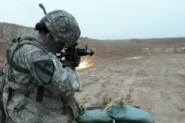 BABIL, Iraq - Sgt. Aquila Crigger, a motor transport operator with Company F, 3rd Battalion, 3rd Brigade, 1st Cavalry Division engages targets during the live-fire portion of the Arrowhead Stakes competition held on Contingency Operating Site Kalsu April