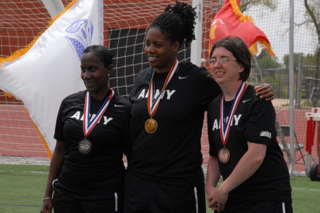 Women's shot put sitting field event medalists pose for the media during the award ceremony at the 2011 Warrior Games Track and Field Competition in Garry Berry Stadium, Colorado Springs, Colo. Jasmine Perry (center) took gold, Marcia Morris-Roberts