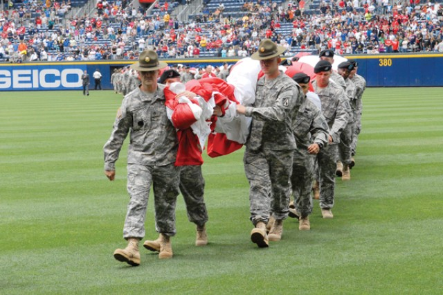 About 115 Soldiers from Fort Benning walk off Turner Field after pulling flag duty during the national anthem prior to Sunday's Braves-Phillies game in Atlanta. More than 100 family members also attended what was the designated venue for Major