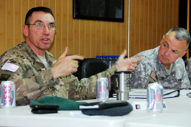 Major General James B. Mallory (left), deputy commanding general, NTM-A/CSTC-A, makes a point as Brig. Gen. Tom Cosentino, DCOM-RS, listens in May 18.