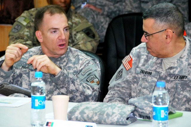 Colonel Greg Baine, RSC-South commander, and Col. Mario Trevino, deputy director, Combined Joint-Engineering, NTM-A/CSTC-A, converse during a conference break May 18.