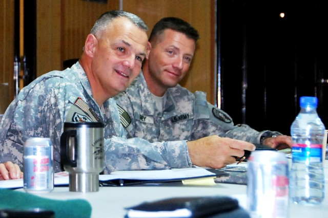Brigadier General Tom Cosentino (left) Deputy Commander-Regional Support, NTM-A/CSTC-A, and Col. Howard Arey, DCOM-RS chief of staff, listen during a comment being made at the RSC Commanders Conference May 18.