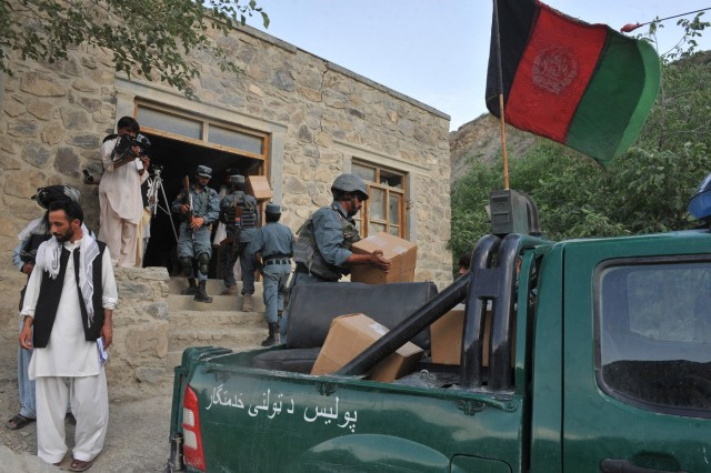 KHOWST PROVINCE, Afghanistan - Afghan National Police deliver medicine to the health clinic in Spera district on May 17. The donation concluded a shura attended by many locals, elders and provincial government officials as well as 1 Division 3rd Brigade