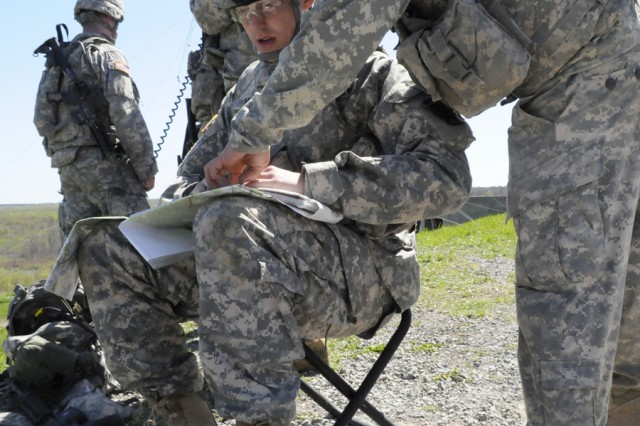 Pfc. Jarad Evans, left, reconfigures safety box coordinates on a map while Sgt. Donald Mitchell assists him. The Soldiers, both with 2nd Battalion, 14th Infantry Regiment, participated in a field artillery exercise May 11 at Fort Drum's Outpost 4.