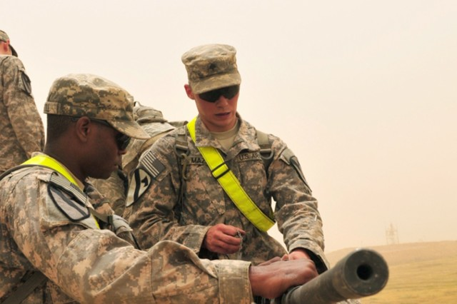 CONTINGENCY OPERATING SITE WARRIOR, Iraq - 1st Lt. Tyrie Carroll, left, platoon leader, Headquarters and Headquarters Company, 2nd Battalion, 12th Cavalry Regiment, 1st Advise and Assist Task Force, 1st Infantry Division, and Spc. Josh Maze, an
