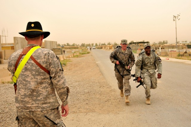 CONTINGENCY OPERATING SITE WARRIOR, Iraq - Sgt. Steven Bryant, a native of Dallas, and Spc. Tim Haubenshild, a native of Waukesha, Wis., both infantrymen serving with Company D, 2nd Battalion, 12th Cavalry Regiment, 1st Advise and Assist Task Force, 1st