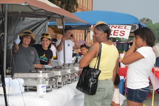 Hispanic Heritage Club member Yazmin Gonzalez gives a thumbs up at the Puerto Rican food booth May 15.
