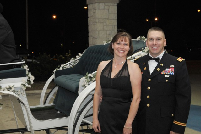 KILLEEN, Texas- Lt. Col. Matthew Ruedi, commander of the 15th Brigade Support Battalion, 2nd Brigade Combat Team, 1st Cavalry Division, and his wife Cindy, pose for a photo in front of a horse drawn carriage outside the Killeen Civic and Conference