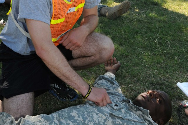 FORT HOOD, Texas- Pvt. Adam Lucier, a Flint, Mich. native and transportation specialist for A. Company, 15th Brigade Support Battalion, 2nd Brigade Combat Team, 1st Cavalry Division, practices performing first aid on a fellow Soldier for the evaluating