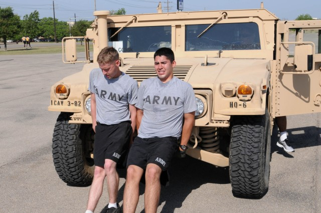 FORT HOOD, Texas - Spc. Edward Tretter (right), a Utica, N.Y. native and Pfc. David Maloney, a Chicago, Ill. native, both are medics with Headquarters and Headquarters Battery, 3rd Battalion, 82nd Field Artillery Regiment, 2nd Brigade Combat Team, 1st