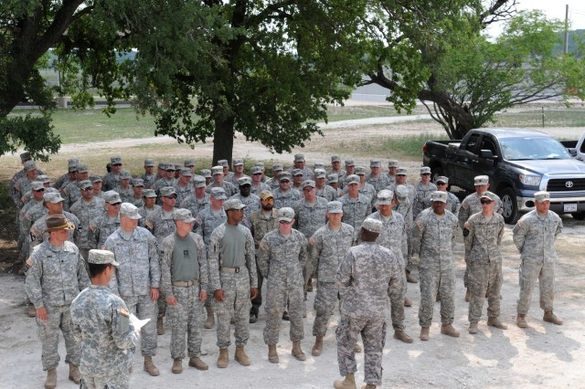FORT HOOD, Texas-Graduates from the Combat Tracker Course, Fort Hood stand in formation to receive a brief before their graduation ceremony on Fort Hood April 21.