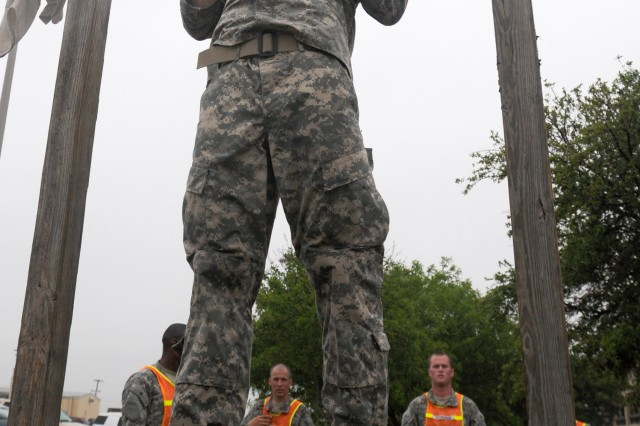 FORT HOOD, Texas-Pfc. Nikki Smith, a Sweet Home, Ore. native and infantryman with B. Company, 1st Battalion, 8th Cavalry Regiment, 2nd Brigade Combat Team, 1st Cavalry Division, performs chin-ups for the pull-up/chin-up event during the B. Co.'s