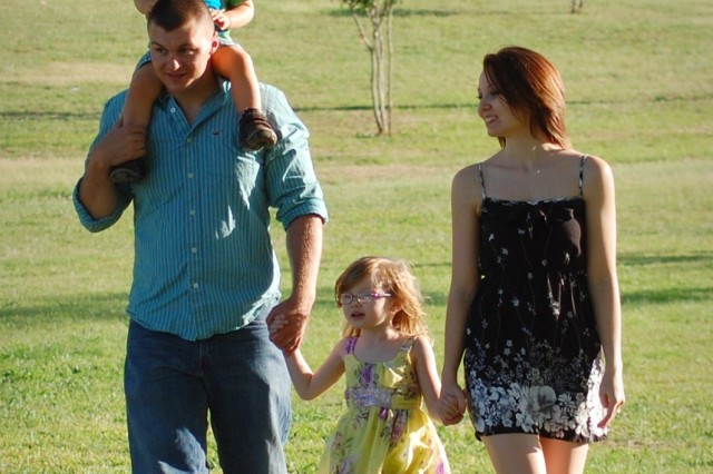 Pvt. Jared Knutson, an infantry Soldier with 2nd Brigade Combat Team, 1st Cavalry Division, walks with wife, Jenni, daughter, Kylie, and son, Dylan, as the family spends time together before Jared's upcoming deployment to Iraq.