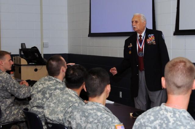Basic Officer Leader Course Students listen to retired Col. Glenn D. Frazier, former POW and Bataan Death March survivor.
