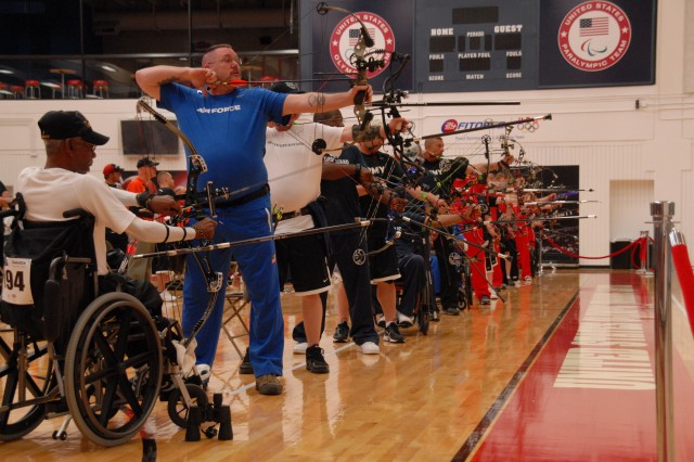 Dwight Hayes, far left, an Army veteran and Special Operations athlete, prepares to shoot the compound bow during a preliminary round at Sports Center I, Olympic Training Center in Colorado, Springs, Colo.