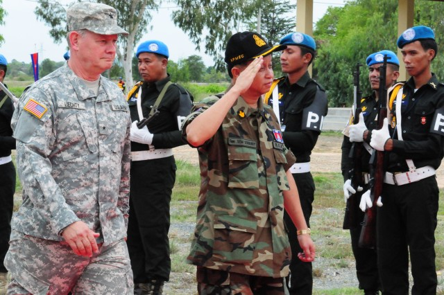 Brig. Gen. Michael Liechty, land component commander, Utah Army National Guard, and Lt. Gen. Sem Sovanny, director-general of the National Center for Peacekeeping Force, Mine and Explosive Remnants of War Clearance, Royal Cambodian Armed Forces, speaks