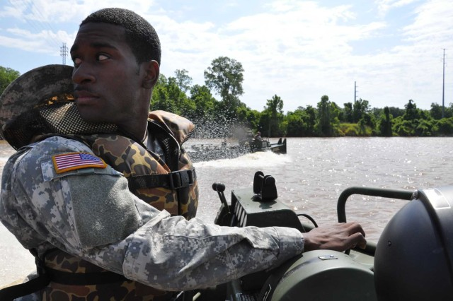 Louisiana National Guard Pfc. Justin Davis of New Orleans operates an MK-2 Bridge Erection Boat in the Red River in Rapides Parish, May 18, 2011. More than 35 members of the 2225th Multi-Role Bridge Company, 205th Engineer Battalion, are staged at Camp