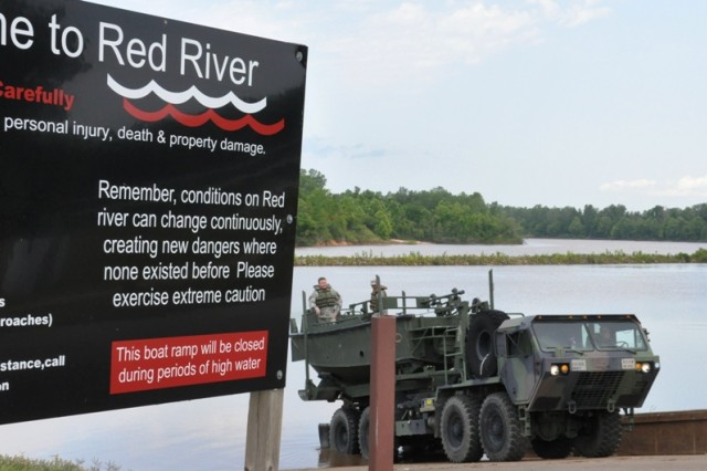 Louisiana National Guard members from the 2225th Multi-Role Bridge Company, 205th Engineer Battalion, deploy an MK-2 Bridge Erection Boat to train for search and rescue missions in the Red River in Rapides Parish, La., May 18, 2011.