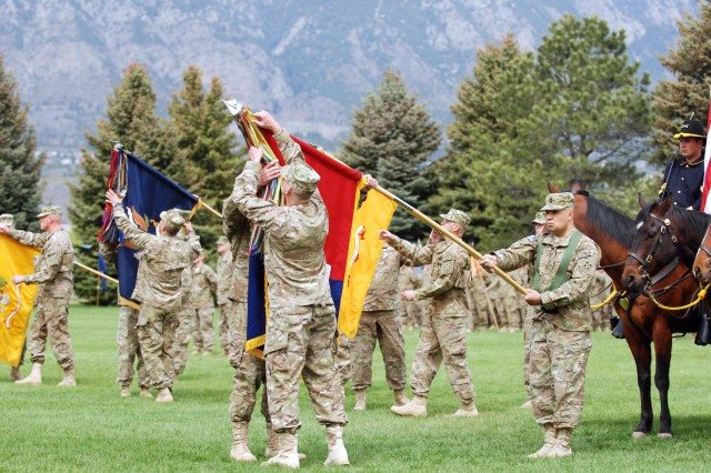 FORT CARSON, Colo. -- Col. John S. Kolasheski, commander, 2nd Brigade Combat Team, 4th Infantry Division, and brigade Command Sgt. Maj. Ralph F. Delosa, case the unit colors during a ceremony signifying unit readiness Tuesday at Manhart Field. The 2nd