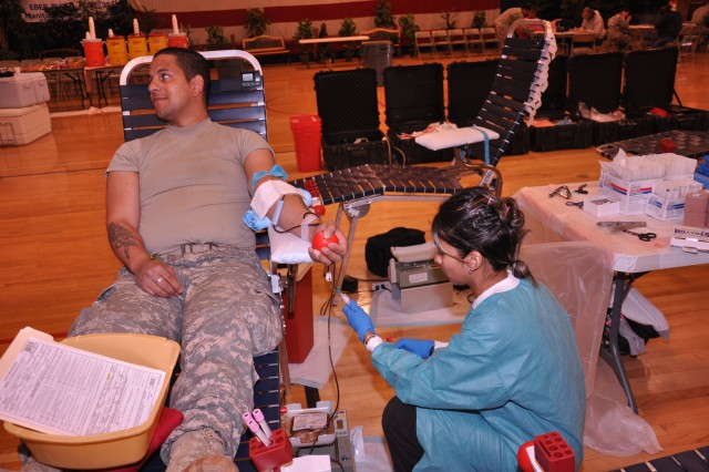 FORT CARSON, Colo. -- Angelica Chavez-Reyes, right, of William Beaumont Army Medical Center, Texas, draws blood from Sgt. Joshua Lipinski, Individual Readiness Training, U.S. Army Garrison Fort Carson, May 12 at the annual blood drive.