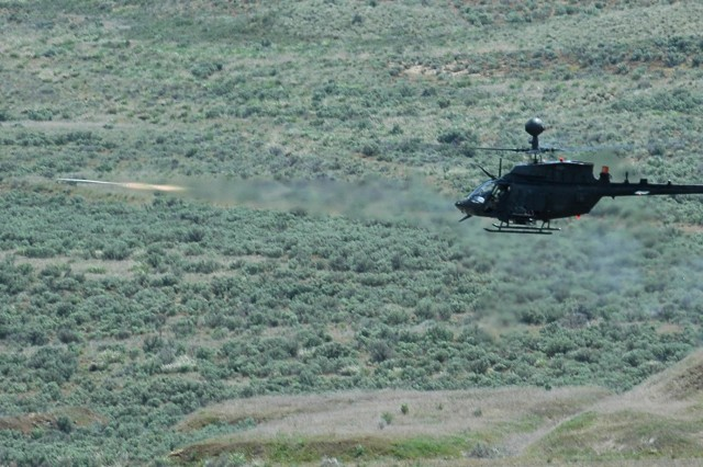Pilots from 4th Squadron, 6th Air Cavalry Regiment, fire a Blue Sphere simulation rocket from their OH-58D Kiowa helicopter during their annual gunnery qualifications at Yakima Training Center, Washington May 17. (U.S. Army Photo by Spc. Ryan Hallock)