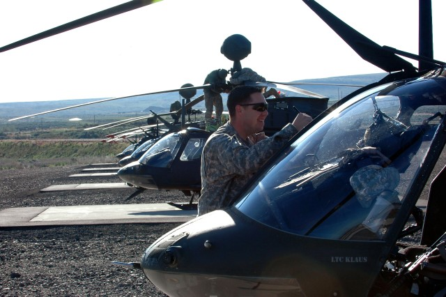 Chief Warrant Officer Nicholas Willden, pilot from Cajun Troop, 4th Squadron, 6th Air Cavalry, gets his OH-58D Kiowa helicopter ready for their annual gunnery qualifications at Yakima Training Center, Washington May 18. (U.S. Army Photo by Spc. Ryan