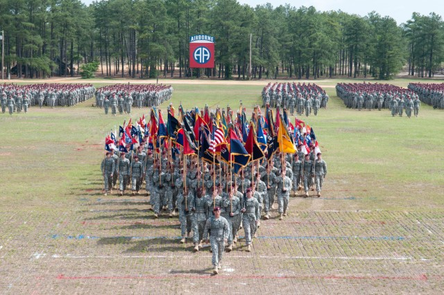 Maj. Gen. Jim Huggins, commanding general of the 82nd Airborne Division, leads a massing of the division's colors in a troop review during All American Week, May 19, 2011, at Fort Bragg, N.C.  All American Week is generally an annual event of