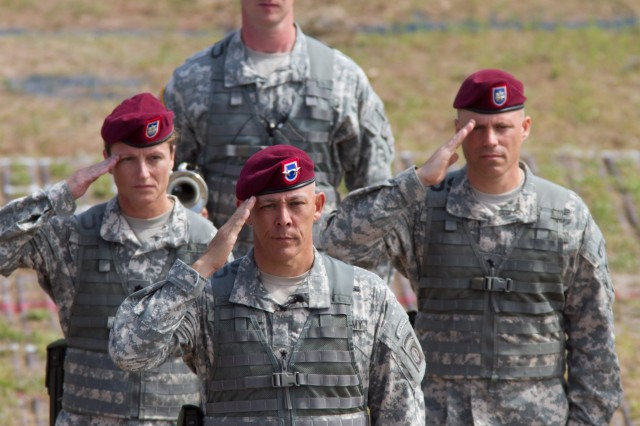 Maj. Gen. Jim Huggins, commanding general of the 82nd Airborne Division, along with a few of his staff, salute a reviewing stand during a review of troops for All American Week, May 19, 2011, at Fort Bragg, N.C.  Huggins has commanded the division since