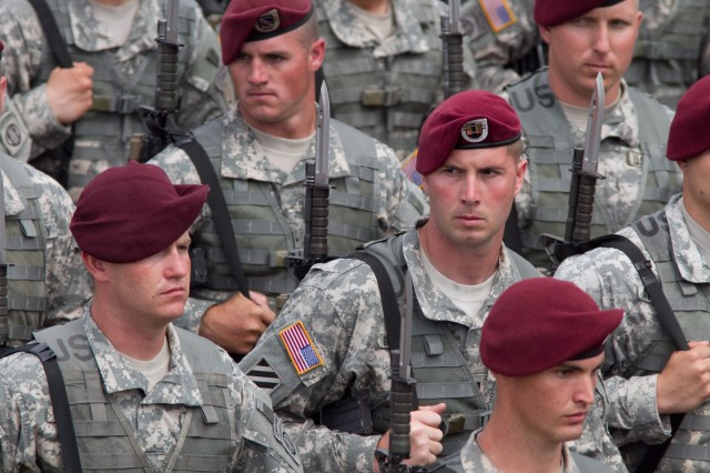 Paratroopers with the 82nd Airborne Division march past a reviewing stand during a division review of troops May 19, 2011, at Fort Bragg, N.C.  The review of troops is one of many events during All American Week, and is attended by active-duty troops,