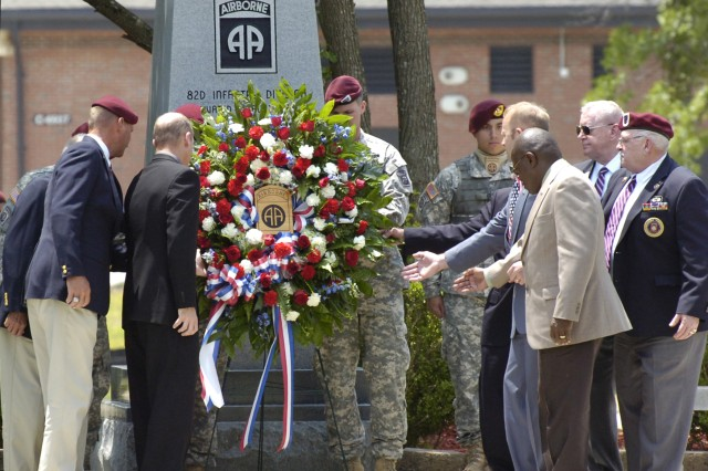 FORT BRAGG, NC - Past and present Paratroopers from the 82nd Airborne Division, representing every conflict the division fought in, present a  wreath at the division's annual memorial ceremony. (US Army photo by Staff Sgt. Andrew T. Alfano, 82nd
