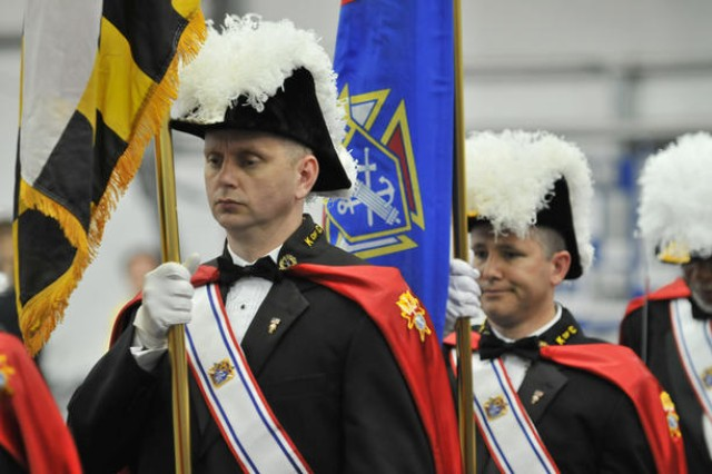 Members of the Knights of Columbus retire their colors at the close of the Massing of the Colors ceremony. An estimated 200 people participated in the color guard processions.