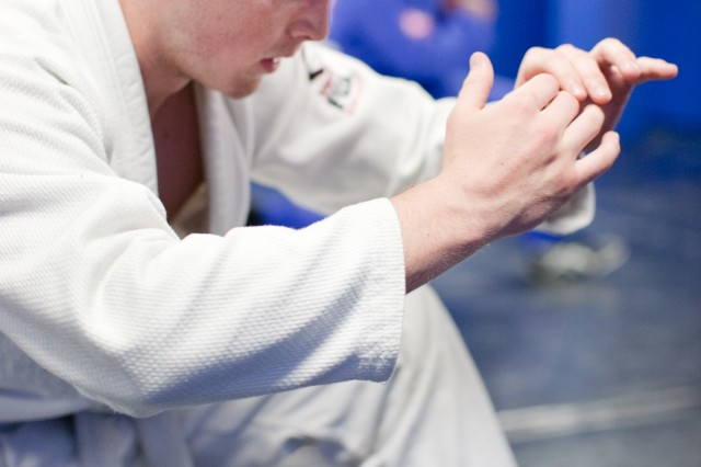 Airman 1st Class Randall Warn, of the 94th Intelligence Squadron, practices a jiujitsu step maneuver during a class at Gaffney Fitness Center. The exercise helps with agility and speed while one's feet are close to the ground.
