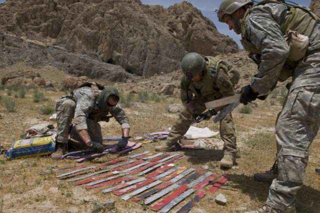 Studying cache found in Afghan cave
