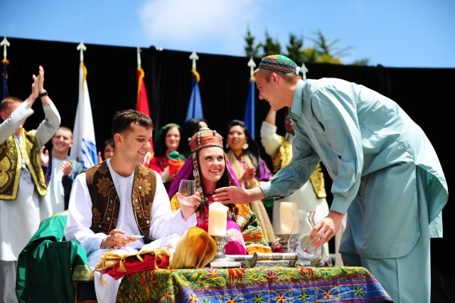 PRESIDIO OF MONTEREY, Calif. - A tradtional Afghan wedding is performed as part of the stage entertainment during Language Day. Demonstrations like these are an important part of educating Language Day visitors about the cultures of the 23 languages