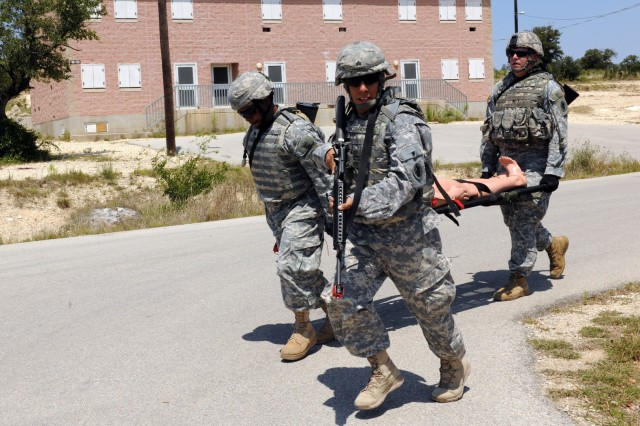 CAMP BULLIS, Texas - (Left to right) Sgt. Donald Coard, Sgt. Jason Longoria and Staff Sgt. Sven Butler evacuate a mock casualty during a U.S. Army South field training exercise here May 17.