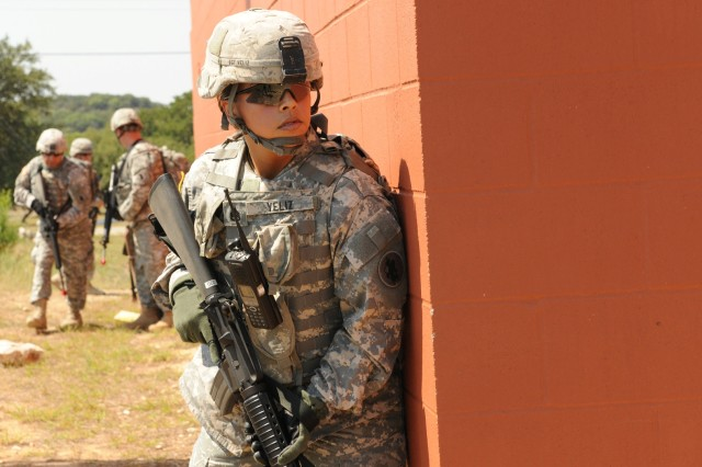 CAMP BULLIS, Texas - Staff Sgt. Viviana Veliz makes her way through a potentially hostile urban area during a U.S. Army South field training exercise here May 17.