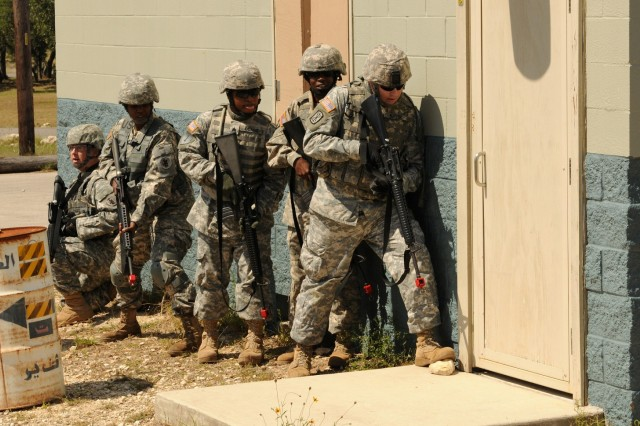 CAMP BULLIS, Texas - (Left to right) Sgt. 1st Class Richard Pittman, Sgt. 1st Class Rholynda Bronson, Sgt. Donald Coard, Sgt. 1st Class Tanshelle Pender and Staff Sgt. Sven Butler prepare to enter and clear a building during a U.S. Army South field