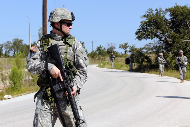 CAMP BULLIS, Texas - Sgt. Larry Birschbach conducts a patrol with his squad during a U.S. Army South field training exercise here May 17.