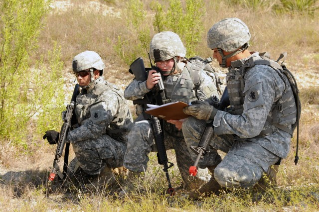 (Left to right) Sgt. Joe Rodriguez, Sgt. Sully Moises and Staff Sgt. Samuel Merced call in for a medical evacuation during a U.S. Army South field training exercise here May 17.