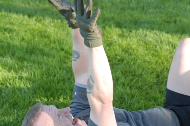 JOINT BASE LEWIS-MCCHORD, Wash. - Command Sgt. Maj. John Troxell, the I Corps Command Sergeant Major tosses a medicine ball into the air during Physically, Mentally, Emotionally Hard Gauntlet, also known as PME Hard Gauntlet, an exercise regimen created