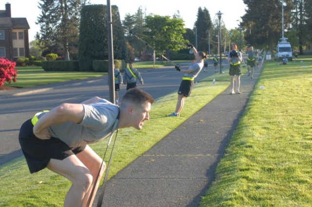 JOINT BASE LEWIS-MCCHORD, Wash. - Members of 2nd Squadron, 1st Cavalry Regiment, 4th Stryker Brigade Combat Team, 2nd Infantry Division, participate in the Physically, Mentally, Emotionally Hard Gauntlet, also known as PME Hard Gauntlet. Roughly 20