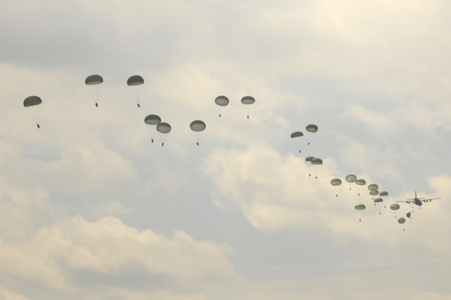 Paratroopers from the 82nd Airborne Division execute a combat jump over Sicily Drop Zone during the Joint Operational Access Demonstration May 20, 2011 at Fort Bragg, N.C. The JOAD was the final event capping the week-long celebration of the