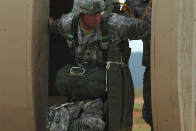 A jumpmaster with 3rd Brigade Combat Team, 82nd Airborne Division, looks out the paratroop door of a mock C-130 Hercules aircraft during the Joint Operational Access Demonstration on May 20, 2011. The event was held at Sicily drop zone on Fort Bragg, NC